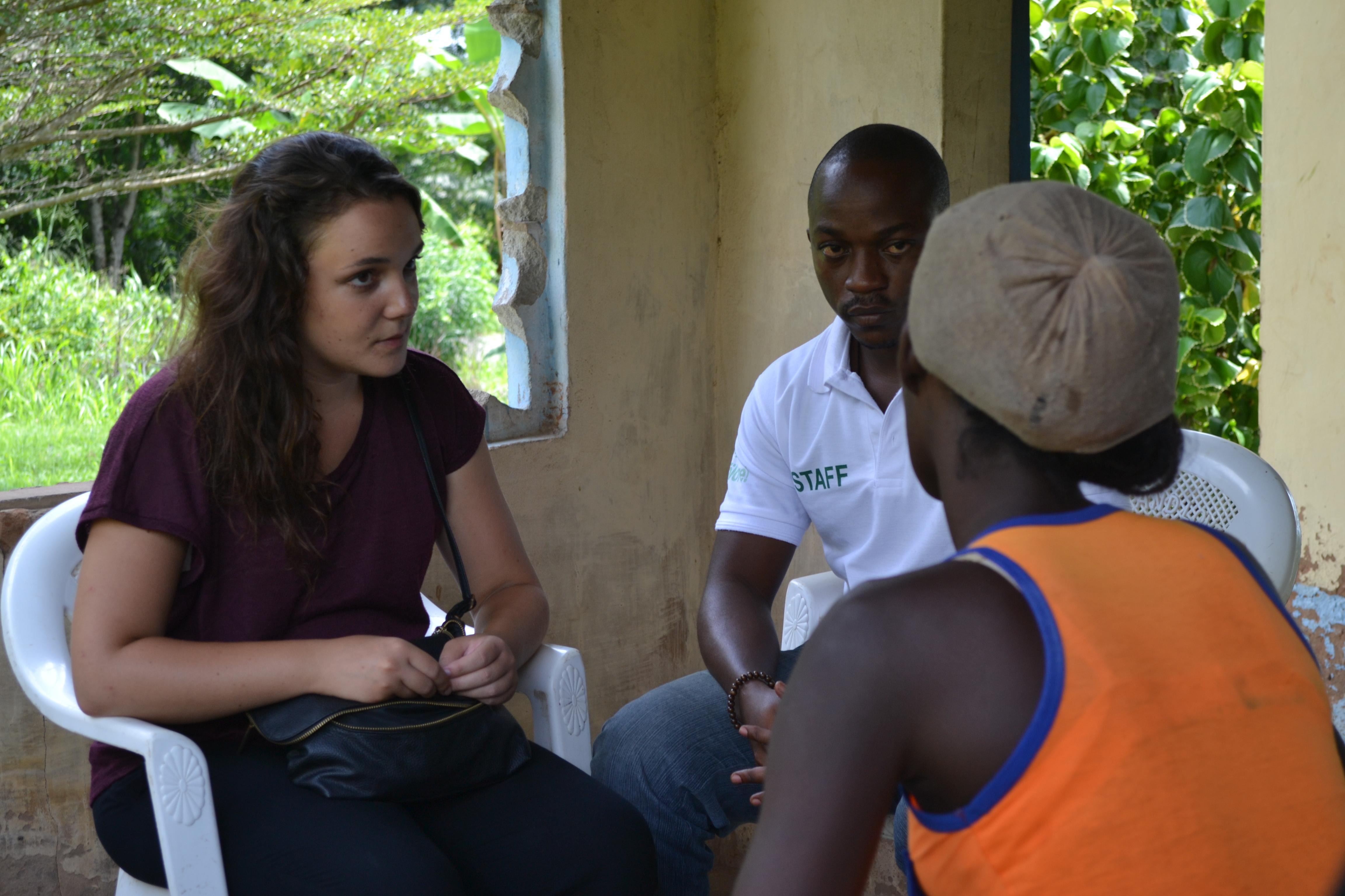 In Ghana, a speech therapy intern and local staff member chat to a patient at the placement location.